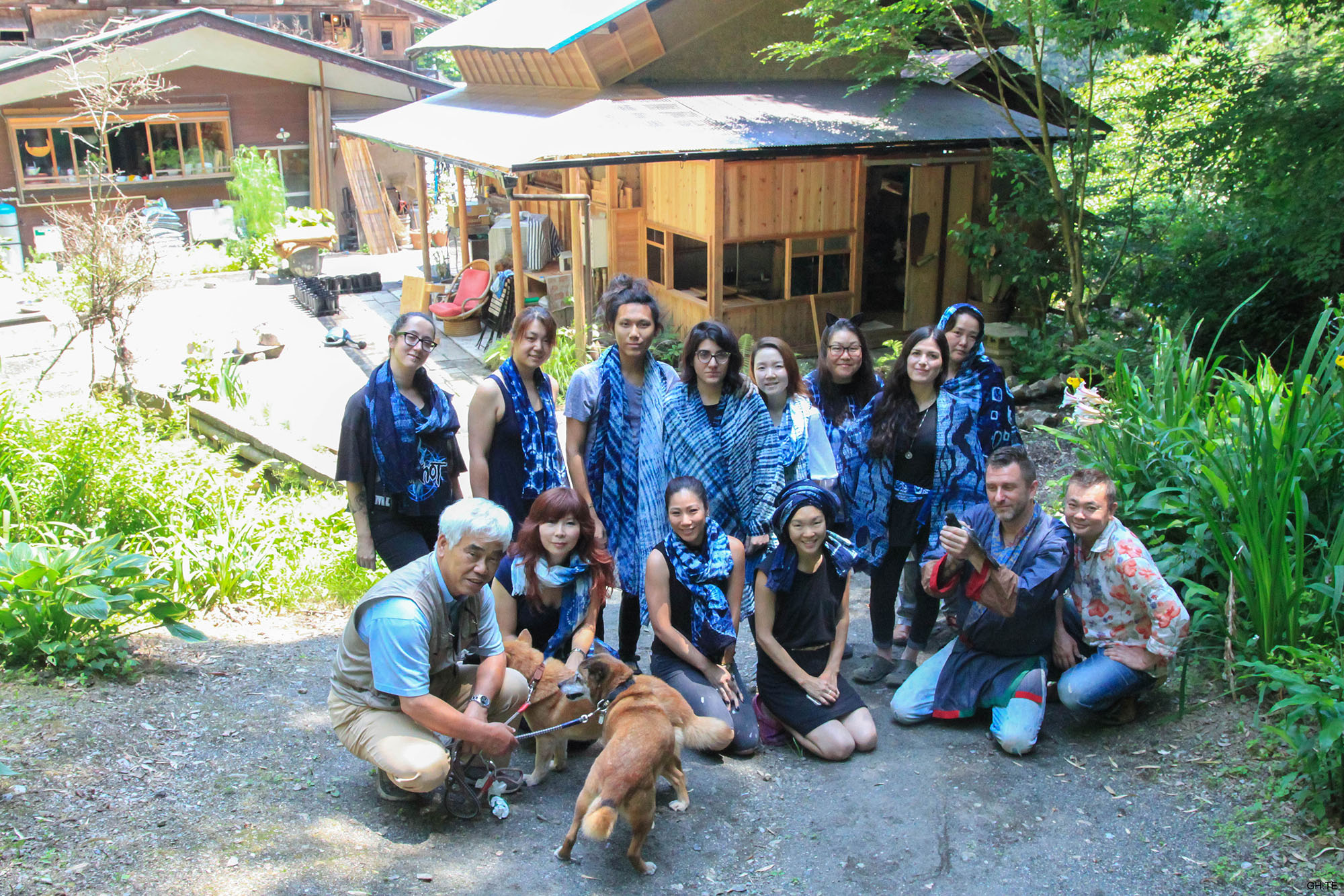 Our indigo dye camp group with Sumi (left kneeling), Bryan (holding pigeon), and Hiro (far right).  Photo by Grace Hsieh