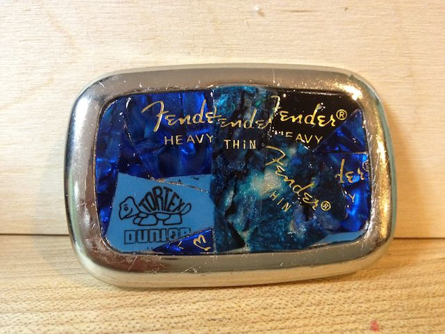 This client is a regional rocker. His wife collected some of his old Fender guitar picks. Vintage by Cathy turned them into a belt buckle for her to give to him for their 20th wedding anniversary.