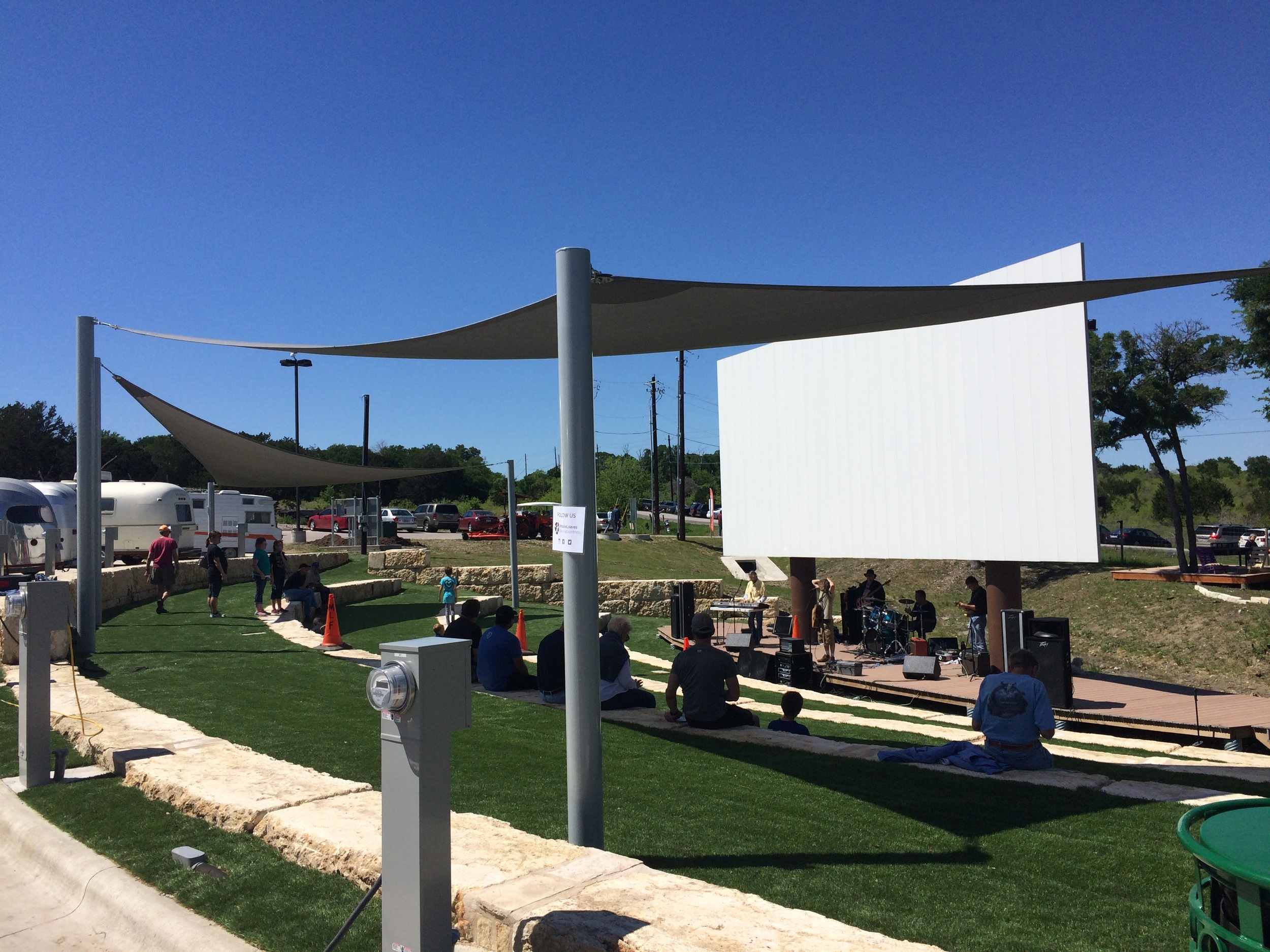 A community amphitheater provides a place to gather for live music and movies.
