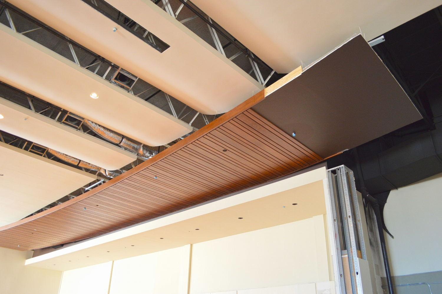Lighting will be installed between the scalloped ceiling reveals in the Sanctuary. The wood slats serve as one of the mechanical distribution devices for this acoustically sensitive space.
