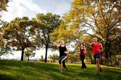 group-of-young-adults-training-martial-arts-in-the-park.jpg