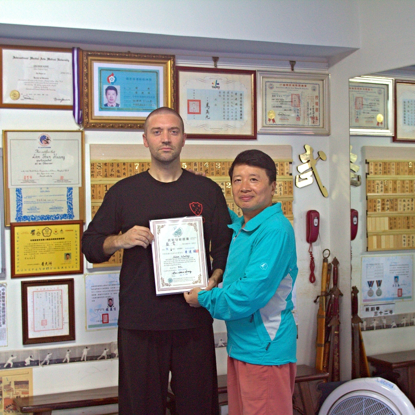 woolsey receives his 5th degree black certificate from Huang