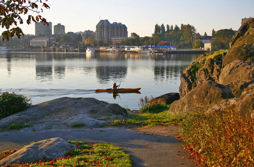 Kayaker paddling in Victoria's Inner Harbour. Photo: Victoria Tourism