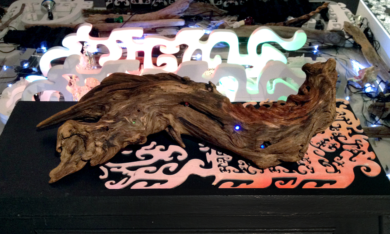 Untitled (Driftwood Strobe) , 2013 hand-carved driftwood treated with mineral oil, LED lights that strobe in response to light levels approx.8 x 22 x 8 inches
