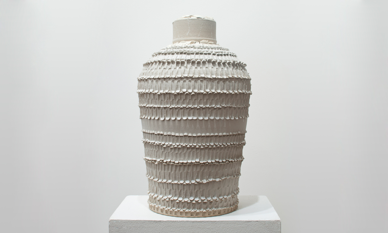 A Sooner Urn , 2013 glazed ceramic, immolated family heirloom 24 x 14 x 14 inches