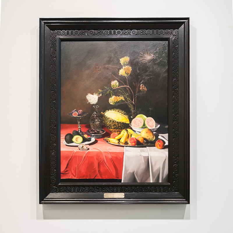 Still life with fruits and flowers pollinated and dispersed by fruit bats , 2016 Oil on canvas on panel, carved frame with representations of Zoonotic Viruses harbored by fruit bats: SARS-Corona Virus, Ebola, Nipah, Rabies, Hendra, & Marburg 40 x 50 x 3.5 inches
