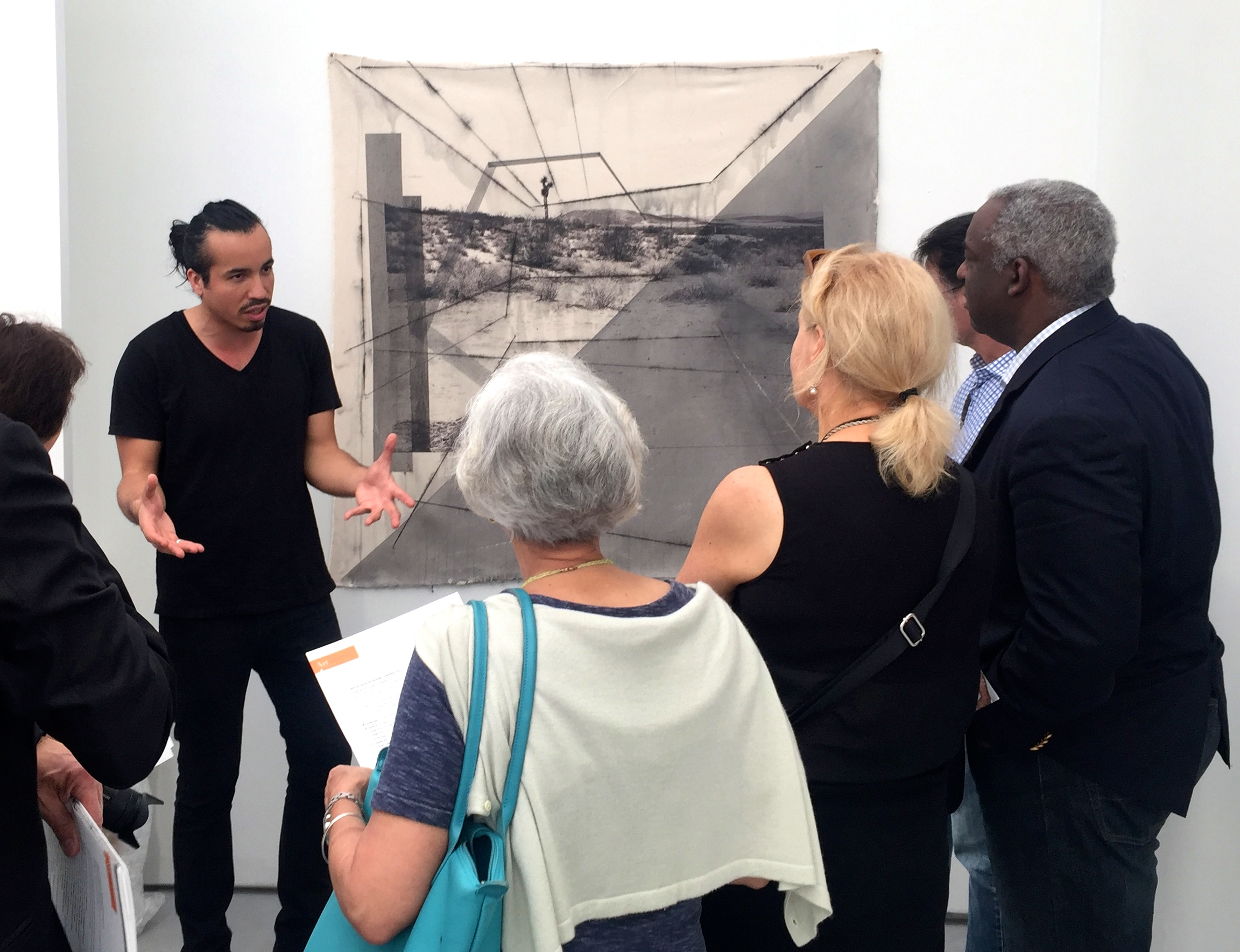 Rodrigo Valenzuela giving a talk during a tour of the Fair. Photo courtesy Artsource Consulting.