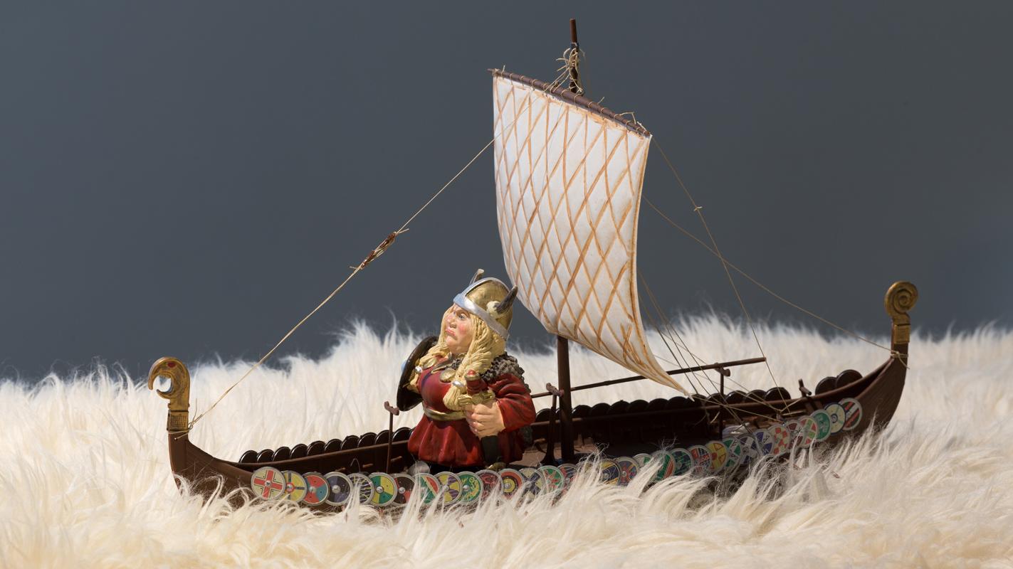 Go You Must , 2017 viking ship, figure, sheepskin; 10.5 x 14.5 x 9 inches (not inclusive of sheepskin)