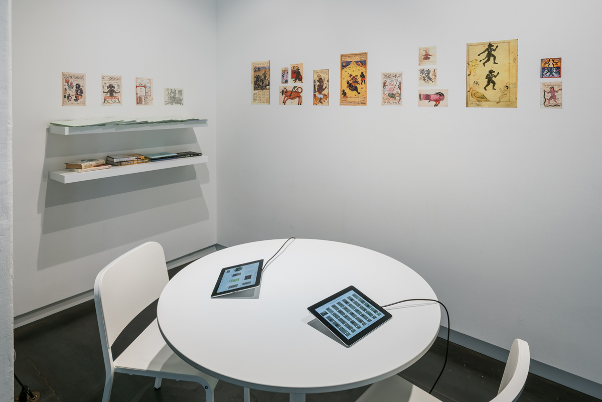 Reading area and archive for  She Who Sees the Unknown: Huma  (exhibition). Allahyari provides her personal research for gallery visitors to peruse. Photo by Mario Gallucci.