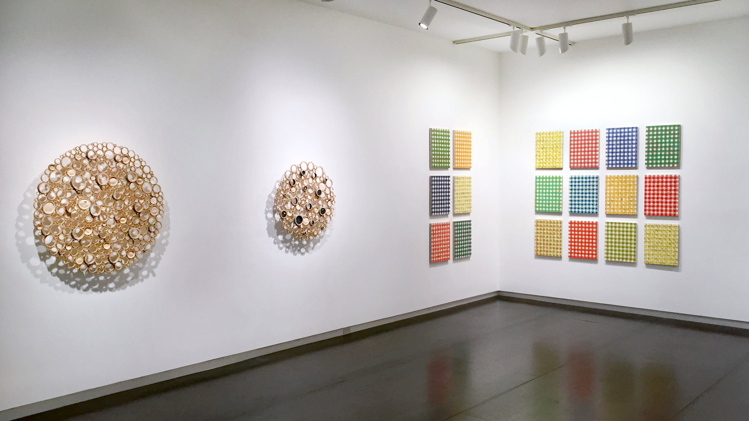 Bamboo wall-hanging works by Anne Crumpacker, gingham oil paintings by Michelle Grabner