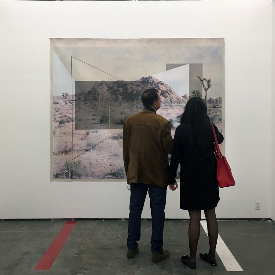 Fair-goers taking in Rodrigo Valenzuela's  New Land No. 6 .