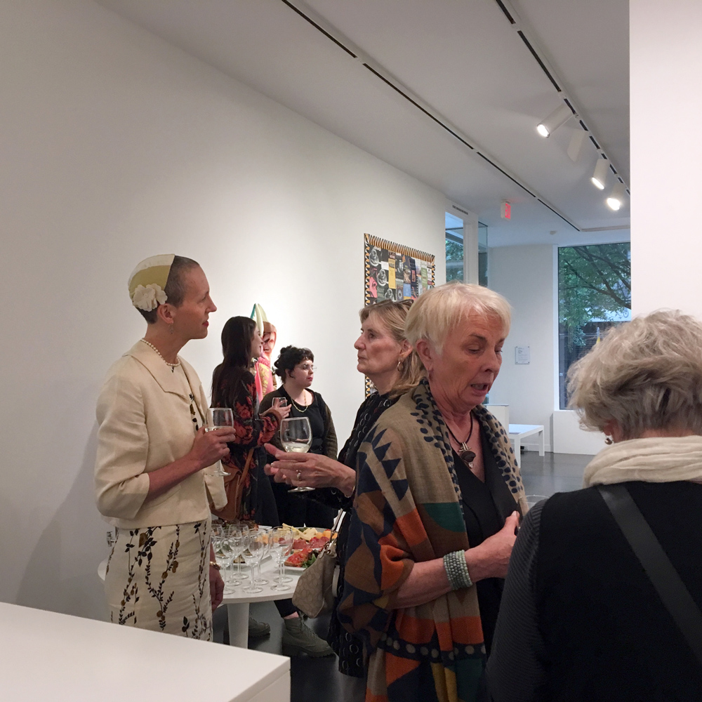 Prior to speaking, artist Julie Green chatted with gallery visitors while enjoying wine and antipasti.