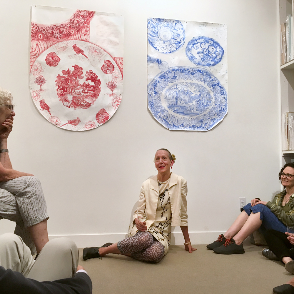 Many, including the artist, sat on the floor for portions of the back room talk with Julie Green.