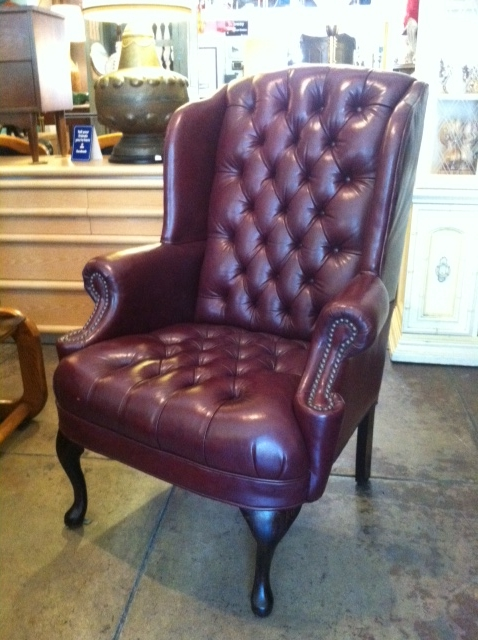oxblood tufted wingback chair