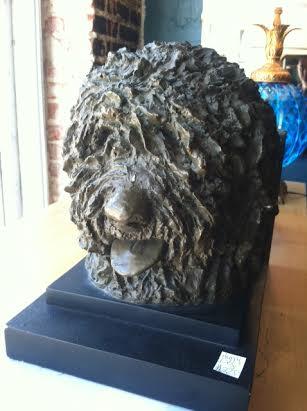 plaster dog sculpture
