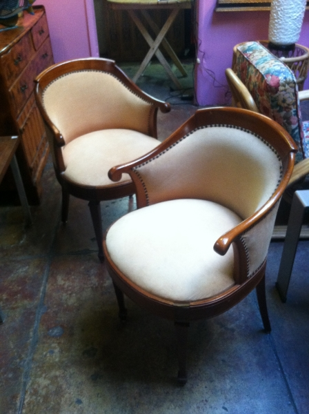 pair of small deco style club chairs