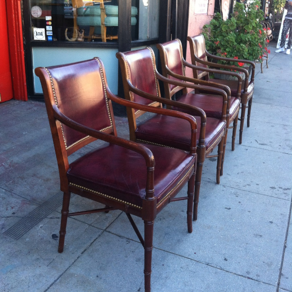 set of four faux bamboo leather arm chairs