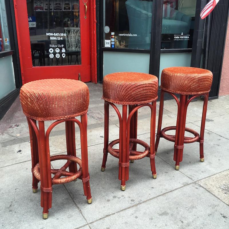 Three Wicker Bar Stools by JANUS et Cie