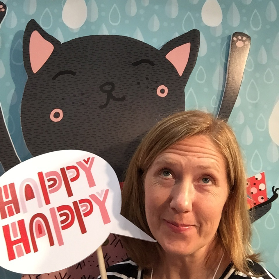 tammie bennett at surtex in happy happy art collective booth