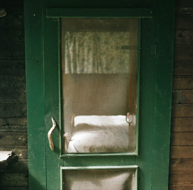 Lise Latreille ,  Icehouse Door  (color photograph)