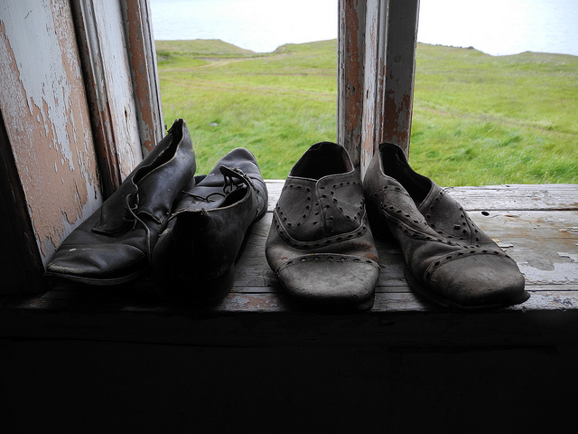 These shoes certainly didn't spend any time shuffling underneath a computer screen; photo from a derelict farmhouse in Iceland, by  Tanja Geis