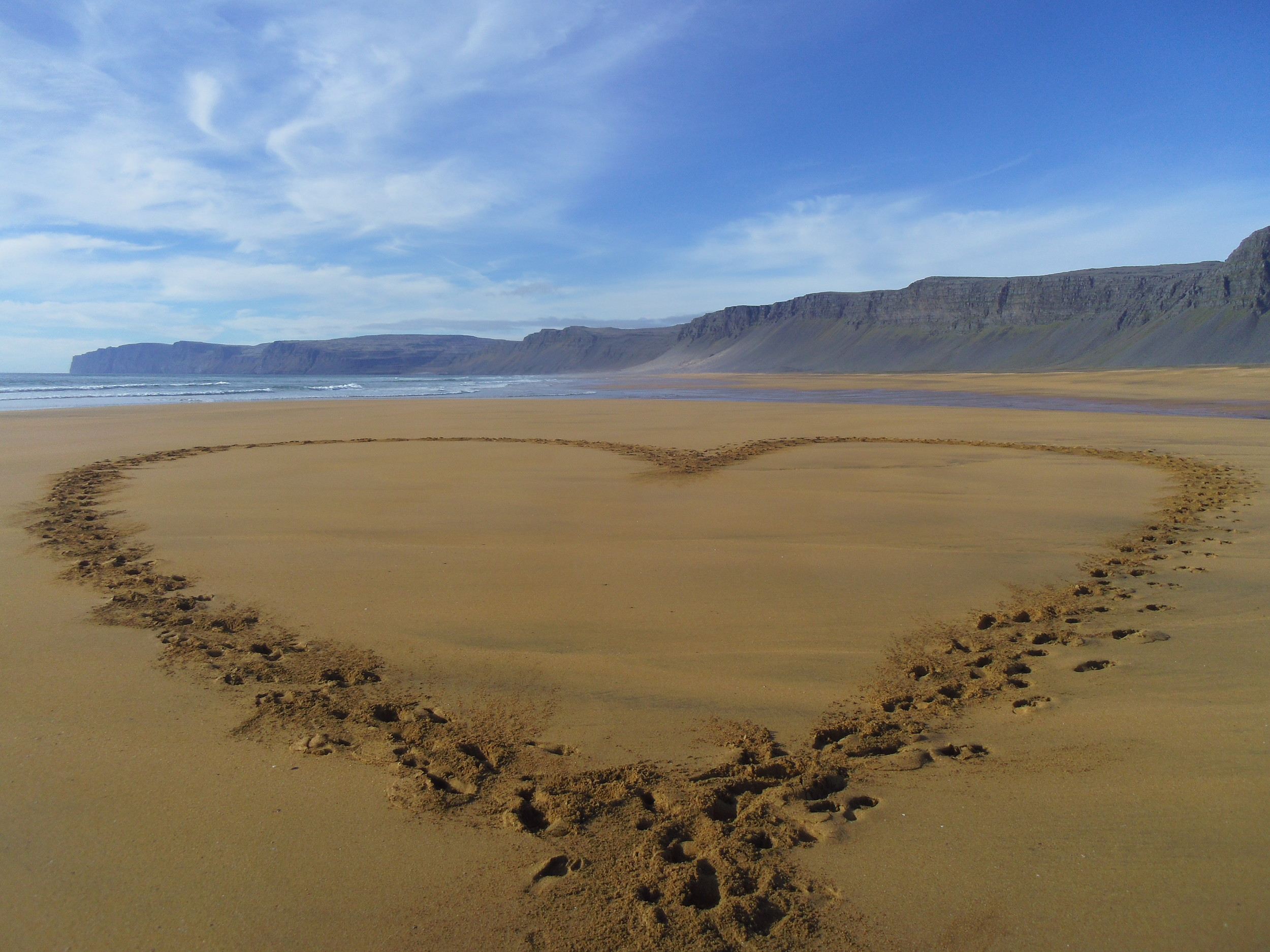 Heart made with feet, Rauðasandur, Westfjords. 10/10 for cheesiness. Photo by Henry Fletcher (who else was there to take it?!)