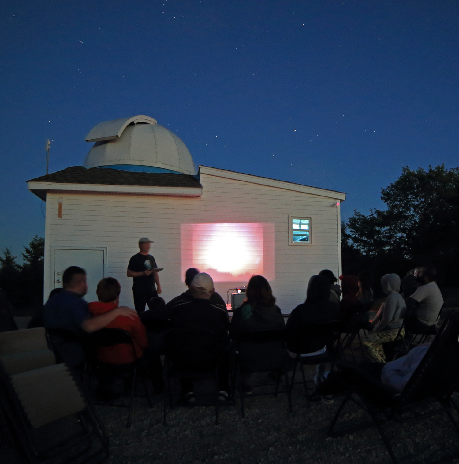 "Tim presents his video lecture session ""al fresca"" on a mild night."