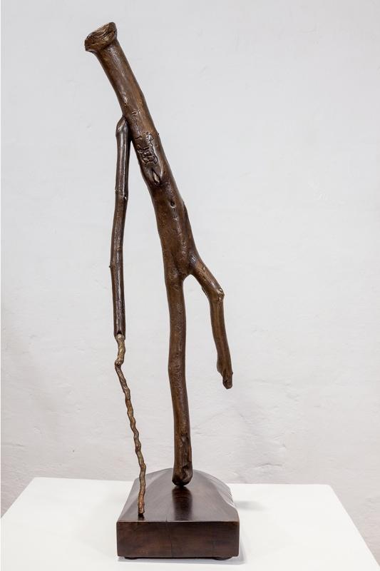 Walks With Cane  cast bronze, 67 x 23 x 20 cm, 2011 - 12 walnut base, steel dowel 5 x 16 x 30 cm, 2012