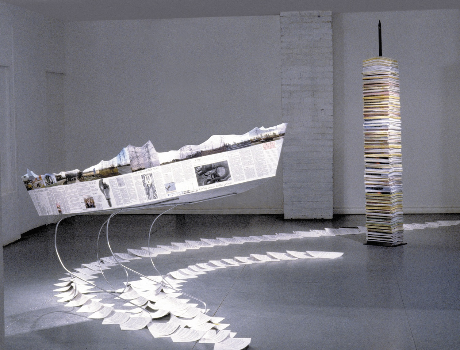 Ship of State , 2004 Wood, paper, steel spike.  Steel spike210 cm, boat on steel stand: 90 x 210 x 90 cm