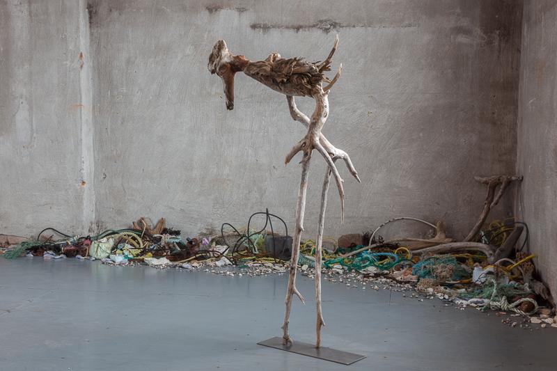 Old Bones , 2011 Newfoundland & Lake Ontario driftwood with Flotsam and Jetsam on floor,110 x 60 x 26 cm