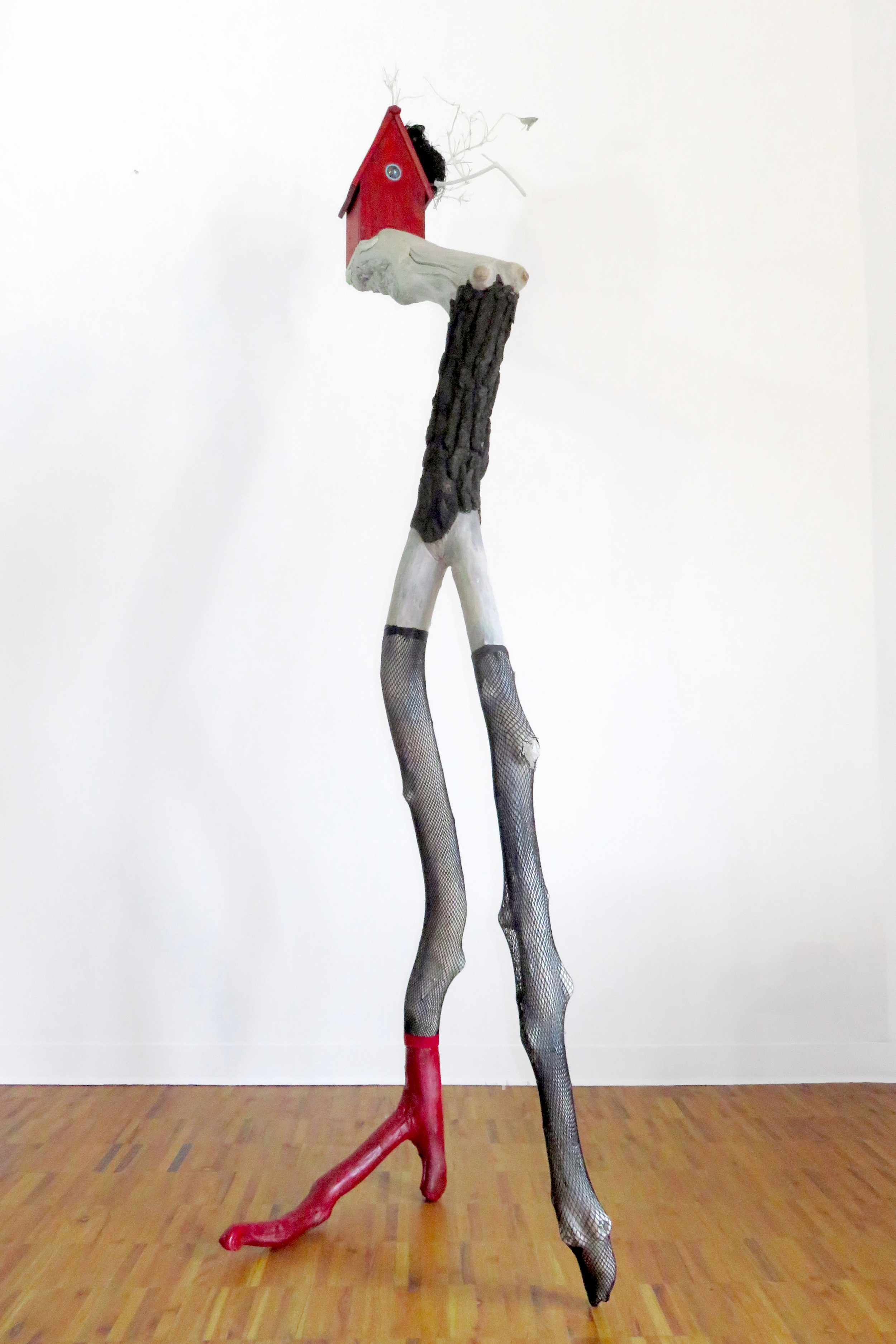 The Fascinator, 2015 Tree limbs, wood house, LED light, glass, bird's nest, nylon stockings, acrylic paints, wood stain, 96 x 30 x 32 inches