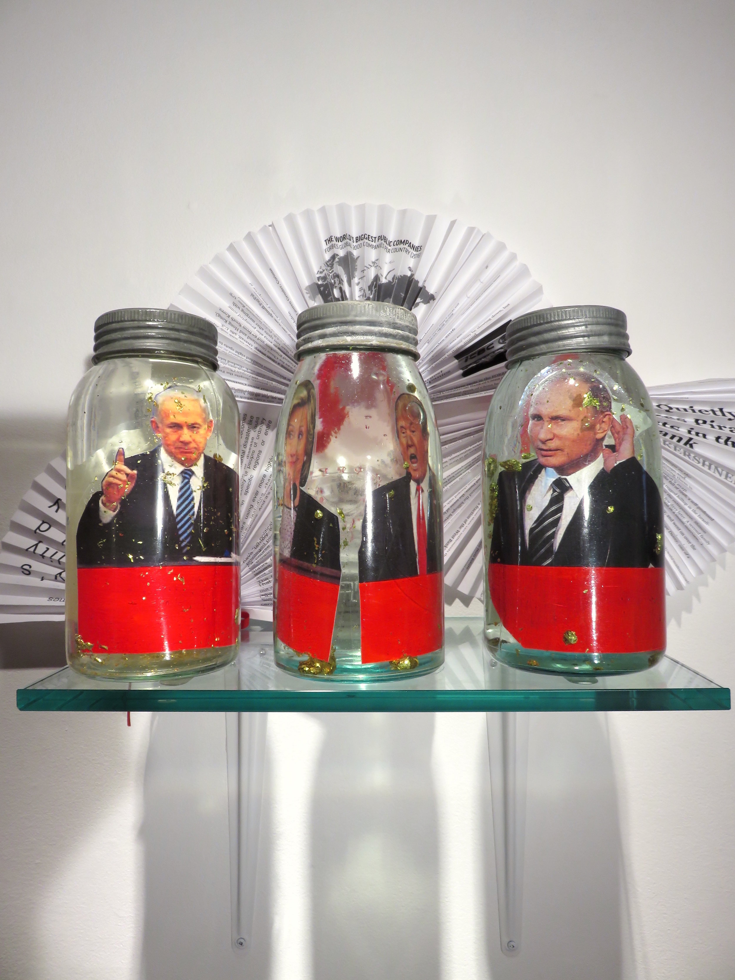 World Powers Vignette , 2016 pickling jars, plastic, paper, metal, 10 x 16 x 11 inches