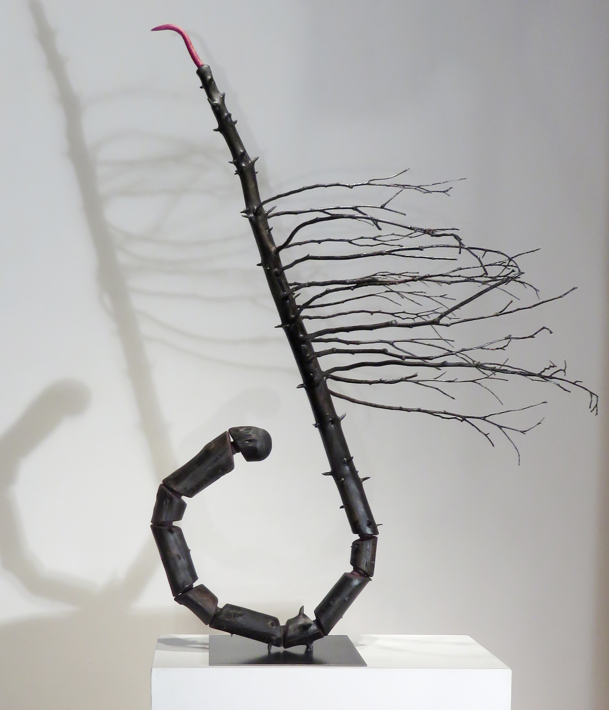 Expectations II,   2016 Spruce tree, cedar branches, foam, acrylic paint, steel base, 50 x 38 x 28 inches