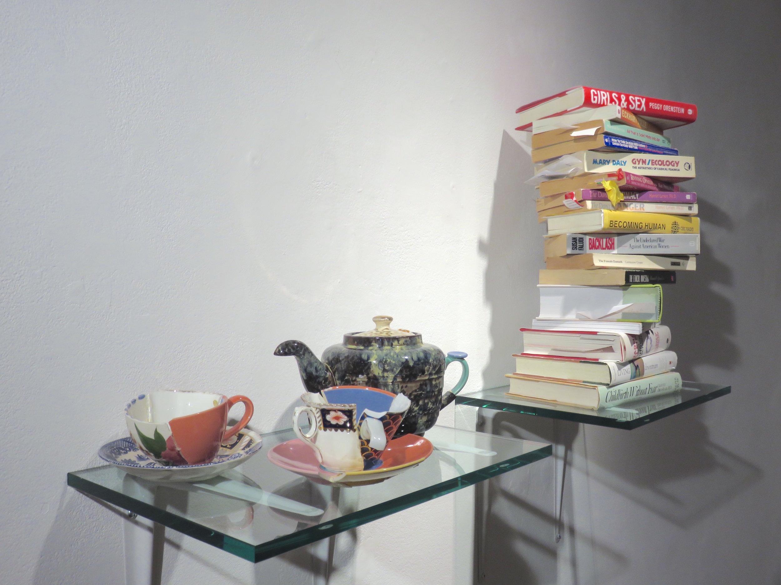 Domestic Vignette II,  2016 broken china, glue, books, 24 x 34 x 11 inches