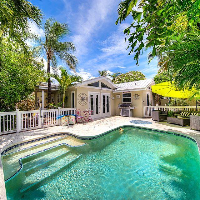 #NEWLISTING  1525 Johnson Street, Key West | $949,000  Listed Exclusively By: Team Spottswood/Vazquez & Terri Spottswood  Bright & airy renovated 3BR/3BA home on a large corner lot in Mid-Town just 3 blocks to the beach & w/in walking distance to many of Key West's amazing restaurants, art galleries & nightlife! Inside you'll find vaulted ceilings, stainless steel appliances, tile flooring through-out & also a den or home office space. Updated w/new impact windows & french doors throughout. The pool has a swim stream for swimming laps & you can rinse off in the outdoor shower. Bricked pathways meander through the irrigated gardens surrounding the home w/tropical fruit trees such as Key Lime, Avocado & Bananas. The property has off street parking, an unfinished pool house & a concrete wall surrounding the home for excellent privacy & added security. Home is priced to sell & listed below appraised value.  For the best professional results in Key West & the Florida Keys, whether its buying or selling, make sure to contact Terri Spottswood & Team Spottswood/Vazquez  tel: 305.432.4848 email: tsv@trumanandcompany.com  www.terrispottswood.com www.keywesthometeam.com  #teamspottswoodvazquez #terrispottswood #homesforsale #picoftheday #photoftheday #igdaily #paradise #keywest #floridakeys #realestate #realtor #hgtv #islandlife #beautiful