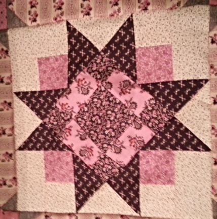 I couldn't resist stitching together a few of the big star blocks. Happy happy!
