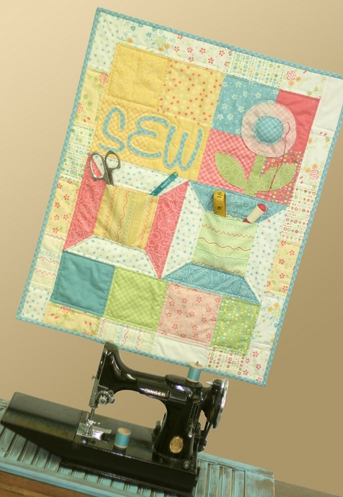 Here is a photo of the quilt from  the pattern author, Sandy Gervais.  Sew cute!! (sewing machine and notions are not included in  giveaway)