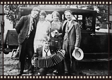 """The name""""30's Playtime"""" brings to mindthe carefree hours of youthfrom a long ago era, as imaged by this charming 'gang' . All of them ready to load into the jalopy and head off to the rural youth dance down a dirt road yonder. That's my grandmother holding the bouquet. She, a farmer's daughter, likely had few leisure hours to herself. This would've been a special day for her to enjoy. She sewed most of her own clothes , probably this lovely dance dress too. It was she and my mother that first taught me to sew, which I loved from the the very first stitch! Now I'm happy to be able have this vintage inspired collection of 1930' prints in our quilt shop. I can hardly wait to pick out a quilt pattern and get stitching!"""