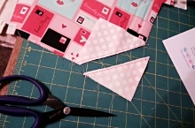 Then, cut between the 2 rows of stitching to trim away that unused corner.
