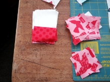 I especially like the Churn Dash block so using some additional fabrics from the  Kiss Kiss  fabric collection by Abi hall, I fussy cut some lovebirds for my center squares, then  used Lipstick Dots and Cloud dots to create the needed units for my churn dash blocks.