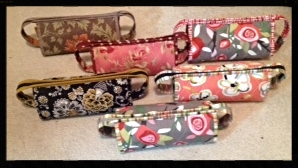 Your Instructor, Debbie Brandeburg's array of Sew Together Bags.  Her photo shows how this wonderful bag takes on a whole new look with the fabric  choices used.