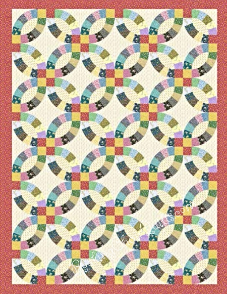 This Double Wedding Ring quilt features the Priarie Flowers fabric. I think this is my favorite!.....O.K. I really love them all and can't decide on a favorite. We will have this in kits for you come November. - Carol