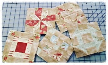 Wendy came by the shop this week and shared her shuffle blocks.  Her fabrics are from the Country Orchard collection by Blackbird Designs for Moda.  Thank you for sharing Wendy!