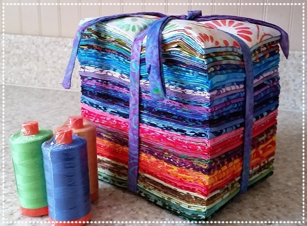Hello you beautiful bright bundle: 40 count fat quarters of Fiji Batiks from Moda Fabrics and 3 AURIFIL BIG SPOOLS of 50 wt MAKO COTTON MSRP $179.99 (yowsa)