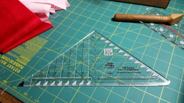 Creative Grids 4 in 1 Half Square Triangle Ruler (CGRBH1). Click on the ruler photo to learn more about this fun tool and watch a product video too.