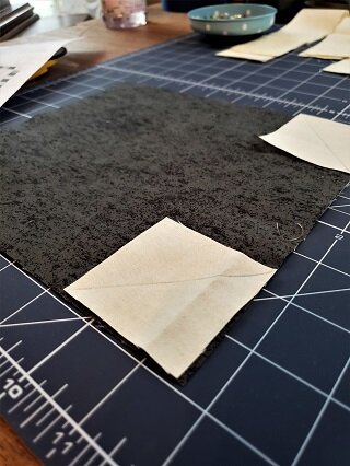 This big block goes together quickly using the pre-cut mini charm squares. A few sew and flip corners & a dozen seams later and your buggy and background are complete. Finish off with an applique triangle on your buggy. So cute!