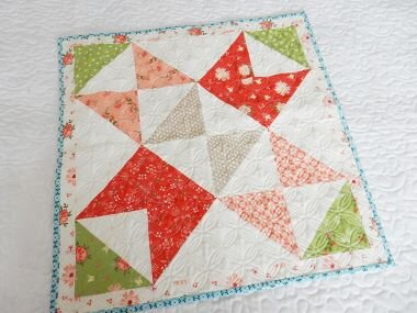 CLICK  on the block to download this free pattern. Chelsi and Sherri's block is made from squares and rectangles that would look great with scrappy mixed colors-with the larger pieces you'll cut to build the block, it's an excellent stashbuster .