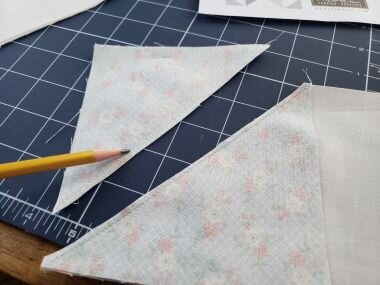 Here you can see second row of stitching after I cut the corner triangle away from the Goose unit. (You cut between the 2 seams you just made)  Since the corner triangles on these BIG BLOCK flying geese units are so large, I don't like to throw them away ( with smaller ones I do)