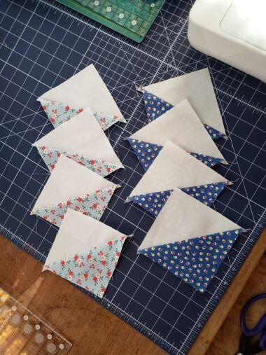 "You will get EIGHT BONUS HSTs from every 18"" Harper's Garden block you make , if you add that second row of stitching to the flying geese units before cutting off the corner triangles. You can use these to make extra blocks or even a bonus quilt if you are making multiple Harper's Garden block."