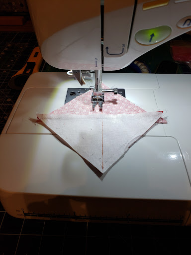 "sew a 1/4"" seam on both sides of your drawn line. Cut apart on the line"